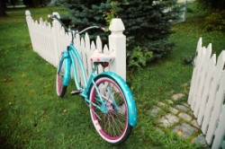 vintage style bike on white picket fence